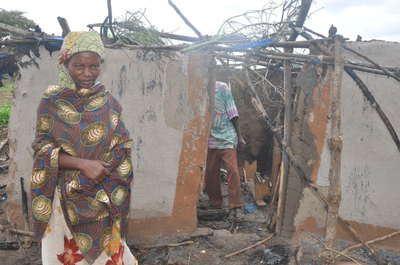 mukandayiro-demitirewo-standing-at-her-burnt-house