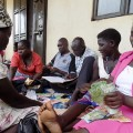 One-of-the-Village-saving-group-members-counts-their-money-ready-for-distribution-in-Moyo-town.PHOTO-BY-SCOVIN-ICETA