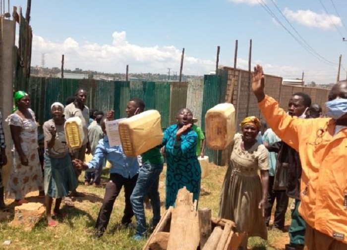 Residents protest against fencing off water source