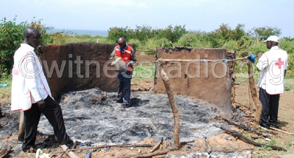 One of the houses of small farmers burnt down by the agents of the land grabbers